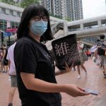 Chinese Activist Under Surveillance Proposes to Jailed Hong Kong Barrister